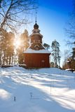 Old wooden church on the Finnish forest in winter.  Royalty Free Stock Images