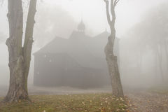 Old wooden church - foggy day, Poland. Stock Image