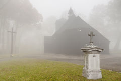 Old wooden church - foggy day, Poland. Royalty Free Stock Photo