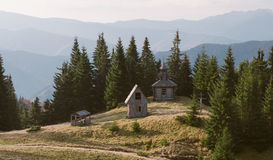 Old wooden church in a forest Stock Photos