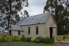 Old wooden church with garden. An historic Australian wooden church with tin roof and garden surrounded by gum trees Stock Photo