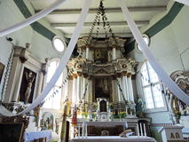 Old wooden church interior , Lithuania Royalty Free Stock Photo
