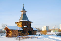 Old wooden church and modern living houses in Moscow. Stock Photography
