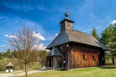 Old wooden church in musem of the Slovak village. Folk architecture stock photos