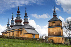 Old wooden church in poland. Blue cloudy sky Stock Photo