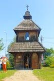 Old wooden church on territory Sorochintsy Fair in Velyki Soroch. Velyki Sorochyntsi, Ukraine - August 20, 2016: Old wooden church on territory Sorochintsy Fair Stock Image