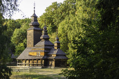 Old wooden church among the trees. Royalty Free Stock Photography