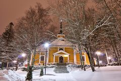 Old wooden church waiting for Christmas. Old wooden church at still snowy scenery in cold christmas night. Ground has snow cover. Everything is ready for service royalty free stock photo