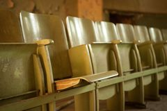 Old wooden cinema seats Royalty Free Stock Image