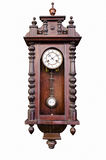 Old wooden clock. Antique wooden pendulum clock isolated on white background Royalty Free Stock Photography