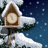 Old wooden clock with fir tree and snow Stock Photography