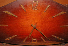 Old wooden clock with rusty arrows Royalty Free Stock Image