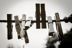Old wooden clothespins on a rope on the street royalty free stock photos