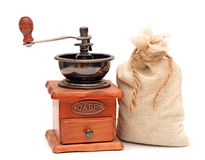 Old wooden coffee grinder, sack with coffee beans Stock Images