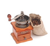 Old wooden coffee grinder, sack with coffee beans Stock Image