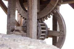Old wooden cogwheels of winch at the well. On the white background Royalty Free Stock Photos