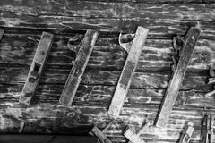 Old Wooden Collection of Vintage Woodworking Tools Jack Plane. On the Wooden Wall of the Stables stock photography