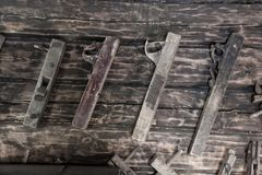 Old Wooden Collection of Vintage Woodworking Tools Jack Plane. On the Wooden Wall of the Stables royalty free stock image