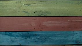 Old wooden colorful plank texture background. The old wooden planks painted in many colors royalty free stock photography