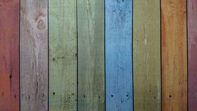 Old wooden colorful plank texture background. The old wooden planks painted in many colors stock photography