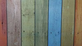 Old wooden colorful plank texture background. The old wooden planks painted in many colors stock photos