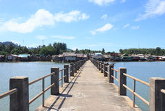 Old wooden and concrete bridge to dock pier tranquil sea destination Stock Photography