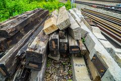 Old wooden and concrete sleepers stacked for disposal. In the railway section was replaced paths Stock Images