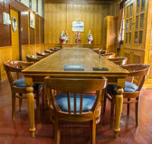 Old wooden conference table. With leather chairs in wooden meeting  room Stock Photos