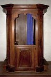 Old wooden confessional Stock Photo