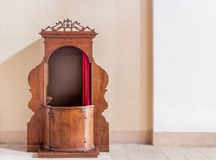 Old wooden confessional Stock Photos
