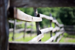 Old wooden corral fence in meadow rural scene bokeh mood Royalty Free Stock Photo