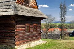 Old wooden cottages in musem of the Slovak village. Old rural cottages in musem of the Slovak village. Folk architecture stock photo