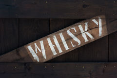 Old wooden crate whiskey. Old aged wooden case of whiskey royalty free stock photo