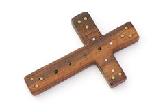 Old wooden cross decorated with beads isolated Royalty Free Stock Photography
