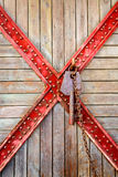 Old wooden and cross metal with rusty key Stock Photography