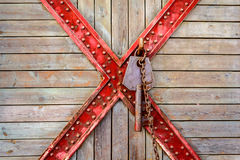 Old wooden and cross metal with rusty key Stock Photos