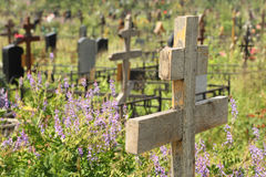 Old wooden cross on overgrown grave Royalty Free Stock Photo