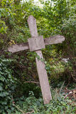 Old wooden cross. Old, peeled wooden cross in a cemetery Royalty Free Stock Photos