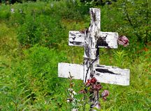 Old wooden cross at a Russian cemetery Stock Images