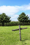 Old Wooden Cross. An old wooden cross at a small rural cemetery stock photo