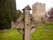 Old wooden cross in Stokesay graveyard. Ancient wooden cross in cemetery of old parish church of Stokesay in Shropshire Royalty Free Stock Images