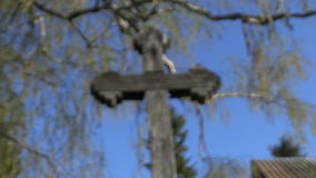 Old wooden cross in village stock video footage