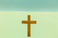 Old wooden cross on wall Stock Image