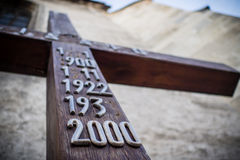 Old wooden crucifix in vintage style with metallic numbers Stock Photography