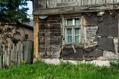 Old wooden, damaged house with window Royalty Free Stock Photos