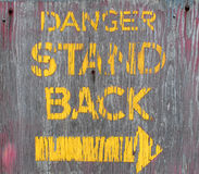 Old wooden danger sign. Royalty Free Stock Images