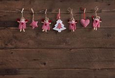 Old wooden dark brown christmas background with handmade red whi Royalty Free Stock Photography
