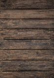 Old wooden dark brown patterned background. Royalty Free Stock Images