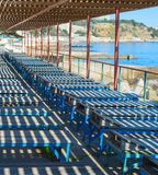 Old wooden deck-chair beach Crimea. Old wooden deck-chairs on the beach of Crimea. Ukraine royalty free stock images