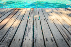 Old Wooden decking floor beside the pool Royalty Free Stock Images